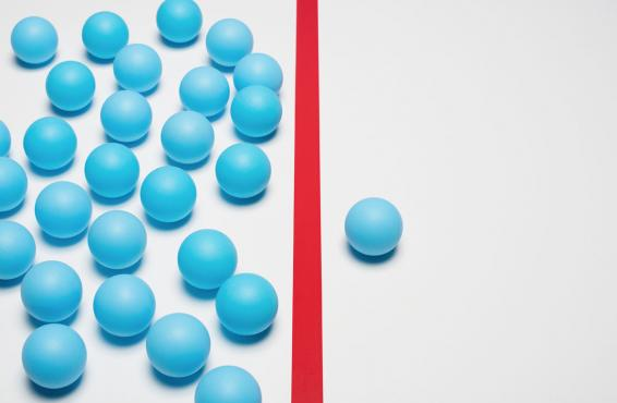 A number of turquoise balls on the left side with a red line down the center and one turquoise ball on the right side.