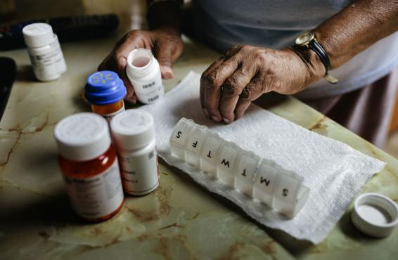 Close-up of person sorting weekly medication