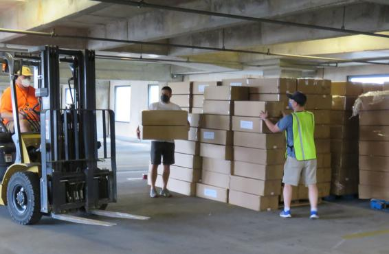 Forklift being used for boxes of N95 masks to be distributed by Texas Medical Association.