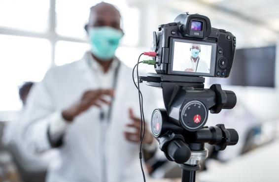 Physician in front of a camera
