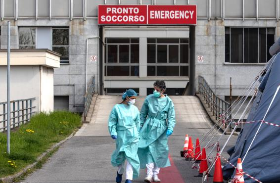 Two doctors outside of emergency room in Italy