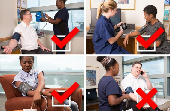 Two medical technicians demonstrate the correct and incorrect way to take blood pressure